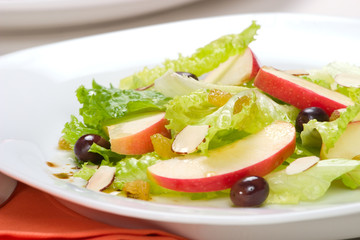 Fall Salad with apples, almonds, raisins  and black olives
