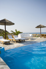 swimming pool by sea at resort hotel luxurious greek island
