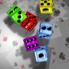 Pair of glass look dice on a background of playing cards