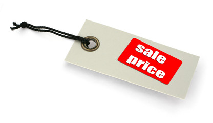 close-up of a Sale tag against white, a small shadow under it,