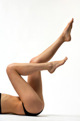 beuatuful long legs on a white background
