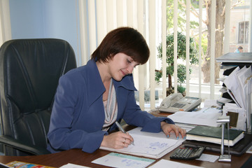 The business woman at office on a workplace
