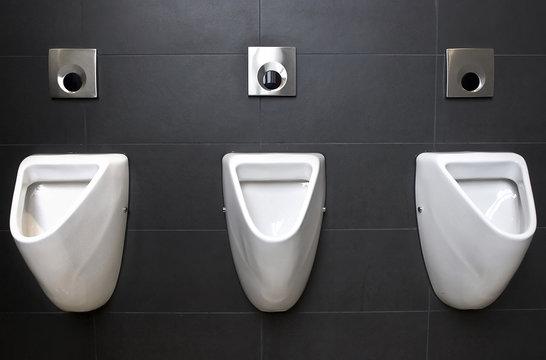 3 urinals on slate