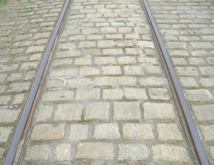 Cobbled Street with Tram Line Rails.