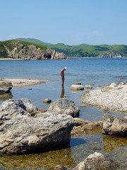 young man on the rocky coast