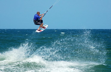 Photo of male kite boarder.