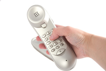 photo of a tone dial telephone in a hand