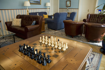 Chess figurines in the luxury room