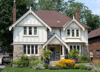 Tudor style house with black eyed susan daisies
