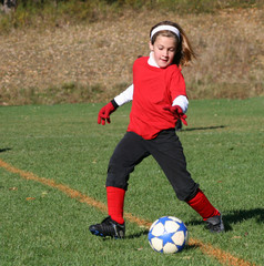Youth Soccer or Football Player in Action