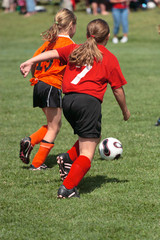 Youth Soccer or Football Player in Action 10