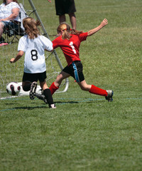 Youth Soccer or Football Player in Action 12