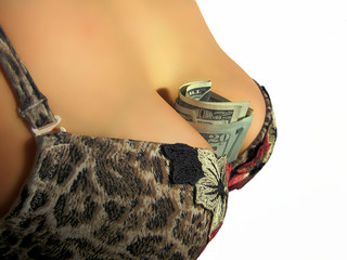 women`s breasts with a money
