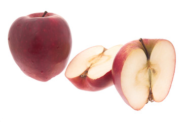 The cut apple on a white background