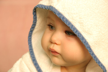 portrait of a baby with hood