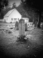 Old Grave in Front of Country Church  in Spotlight Mode