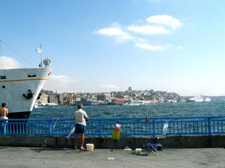 Man and boy fishing in Bosphorus, Istanbul