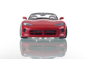 carro do vermelho com reflexão. Foto de estúdio.