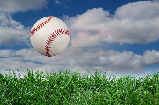 Baseball after impact with grass