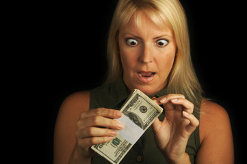 Excited Woman Holding Stack of Money