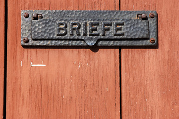 German letter slot in the wooden door