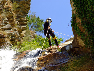 Woman descending on rappel