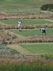 golfers on tee box