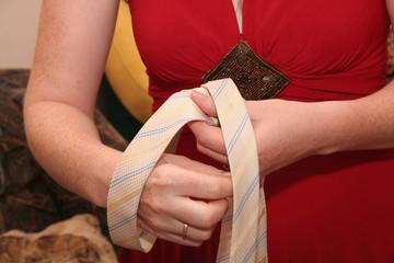 tying a cravat by hands
