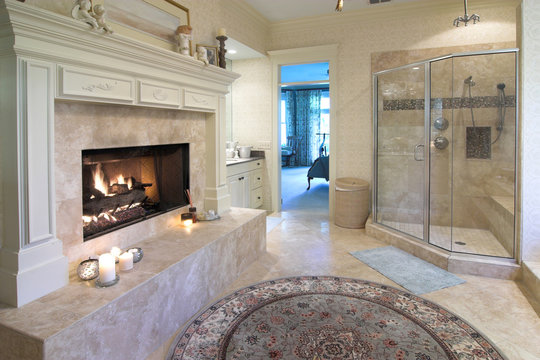 opulent bathroom with fireplace and marble