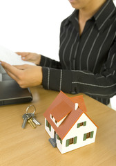 Business woman with little house