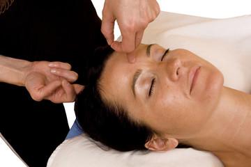 Woman Receives Facial Massage