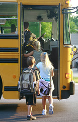 Kids Getting on School Bus