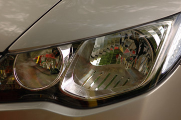head lights of a car , close up view.