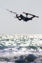 kitesurfer above wave