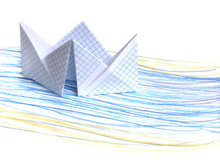 Paper ship on drawing sea background