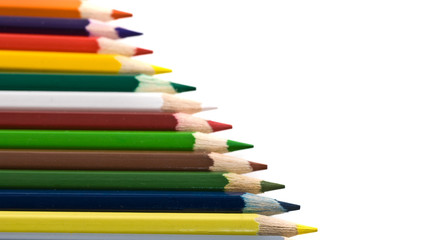 Assortment of coloured pencils isolated over white