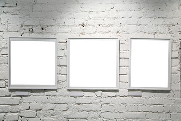 wall in the exebition hall with blank frames