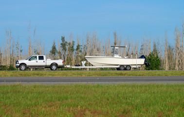 Pickup truck towing fishing boat