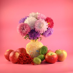 Asters in a vase, a guelder-rose and apples