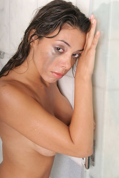 Woman crying in shower