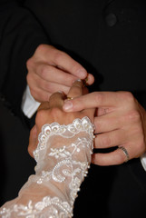 Wedding rings being exchanged