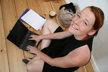 Young woman with laptop smiling