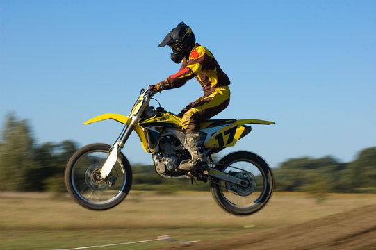Yellow motocross flying