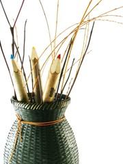 coloured pencils in basket