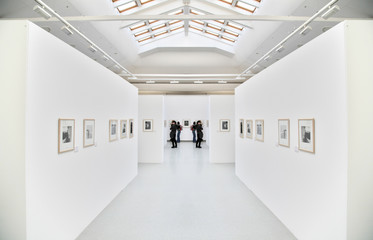 people on the exhibition of the photographs