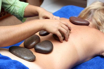 special volcanic stone massage session at a spa center