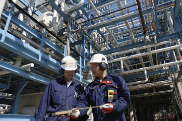 two engineers inside oil refinery