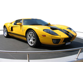 Yellow super car on an exhibition stand