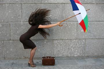 wind, hurricane - girl with umbrella