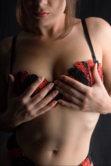 lady wearing a red/black bra